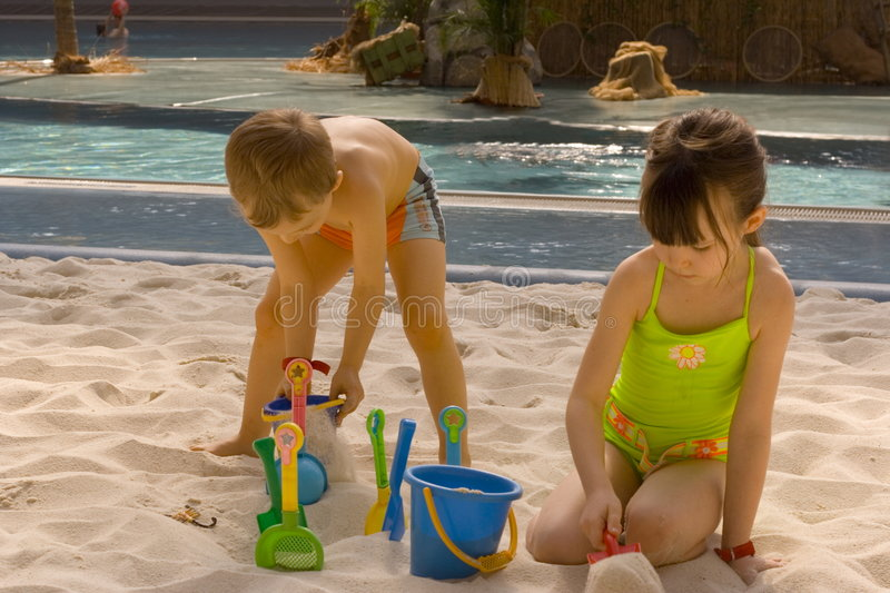 Children play in sand royalty free stock photo
