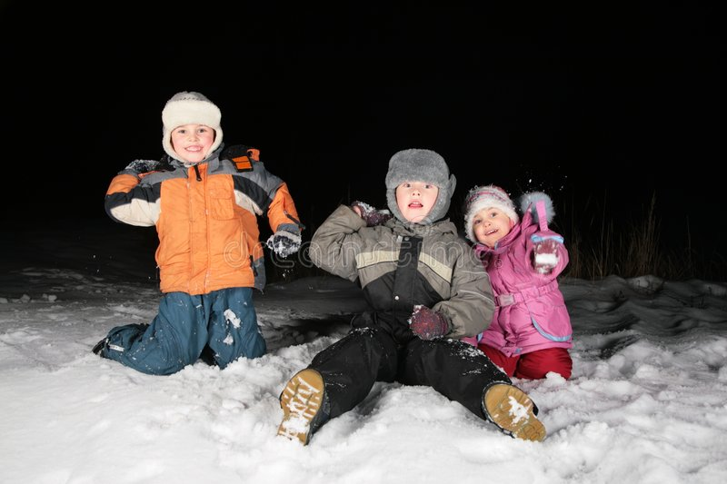 Download Children Play Snowblls In The Night Stock Images - Image: 4485674