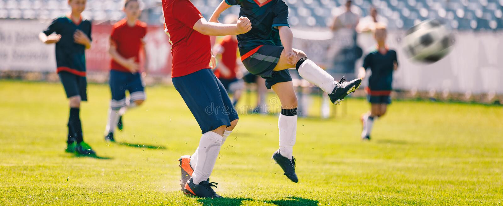 Children Play Soccer Game. Young Boys Running and Kicking Football Ball on Grass Sports Field. Football Final Game of the Youth Tournament royalty free stock photography