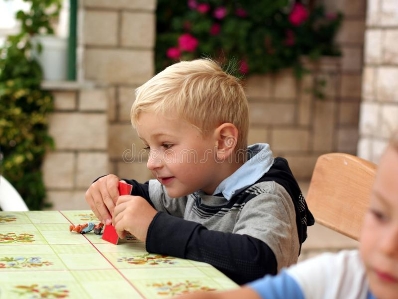 Children play a table game royalty free stock photo