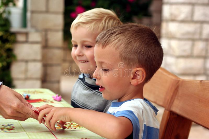 Children play a table game royalty free stock photos