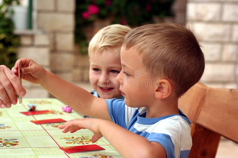 Children play a table game royalty free stock photography