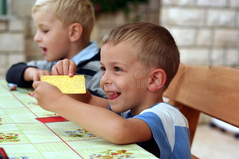 Children play a table game stock photos