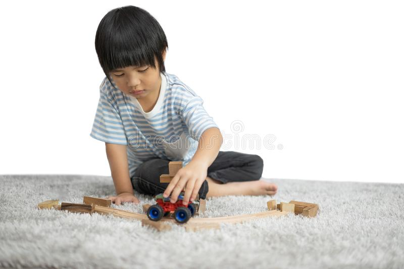 Children play with a toy designer on the floor of the children`s room. Kids playing with colorful blocks. Kindergarten educational royalty free stock images