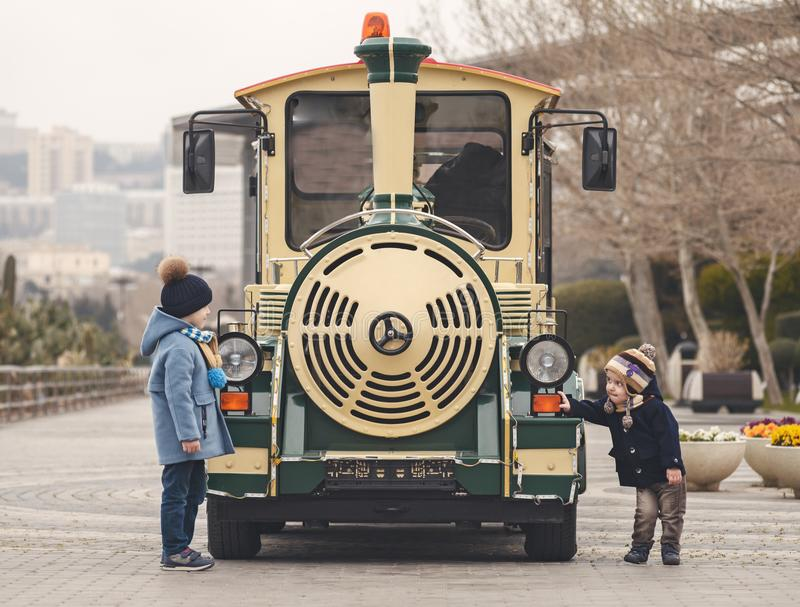 children play at the train stock photos