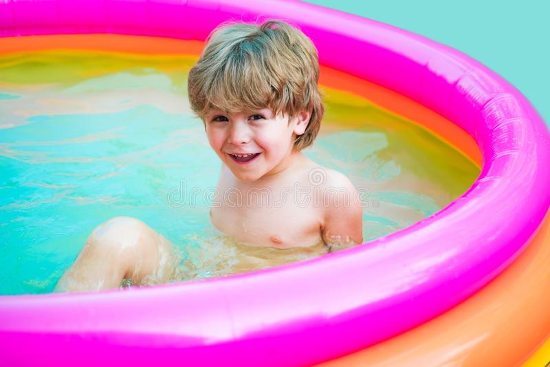 Children play in tropical resort. Child boy and best swimming pool. Cute kid relaxing on swimming pool. Kids Swimming. Pool Concept. Summer vacation. Relax in royalty free stock images