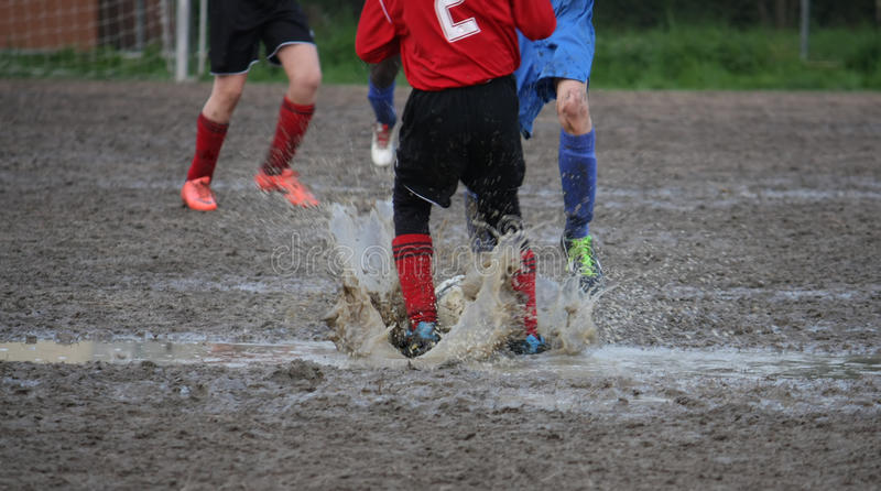 Children players during a football match in a playing field full royalty free stock photography