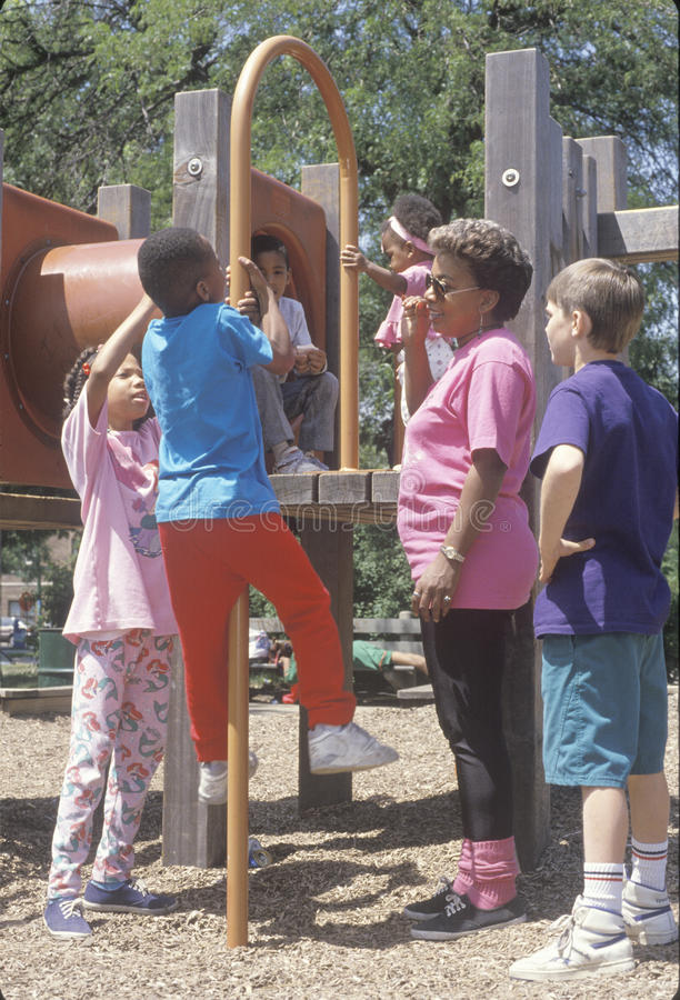 Children at the playground. Under a parent's supervision, Chicago, IL stock photos