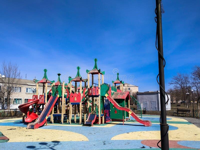 Colourful children playground equipment in park stock photo