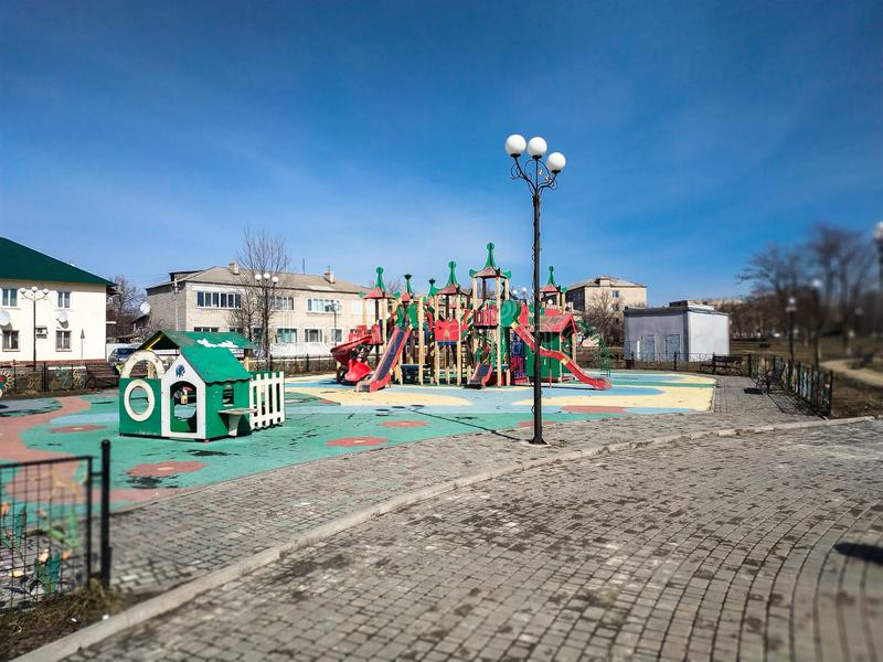 Children playground. Colourful children playground equipment in park.  royalty free stock images