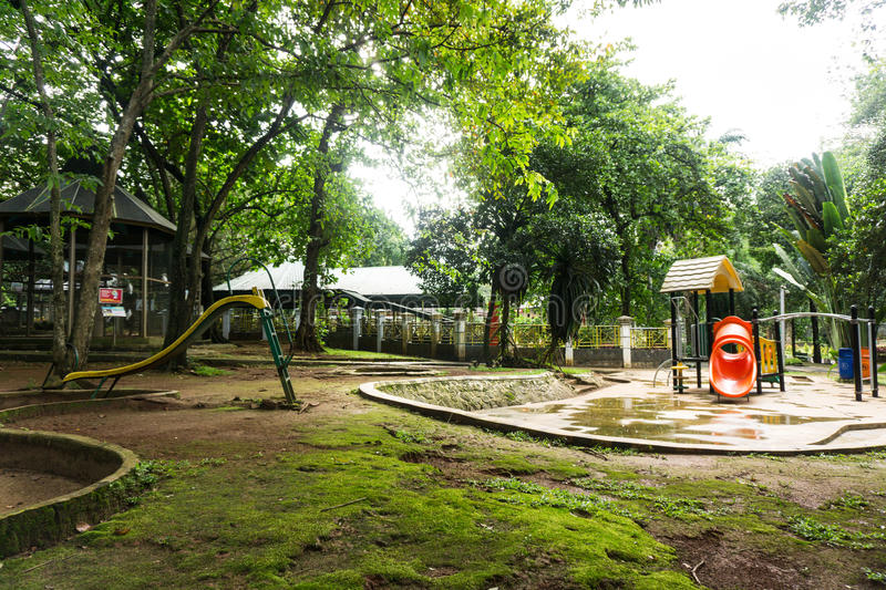 Children playground in the middle of green garden photo taken in Jakarta Indonesia. Java royalty free stock images
