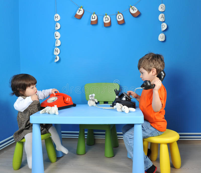 Download Children playing stock photo. Image of phone, chair, child - 25730250