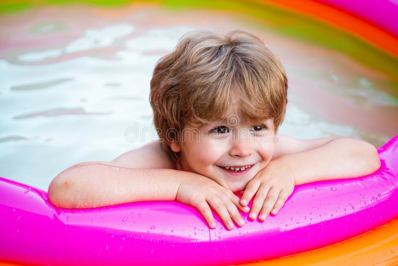 Children playing and active leisure - swimming pool concept. Summer vacation. Child boy and best swimming pool. Kids royalty free stock photo
