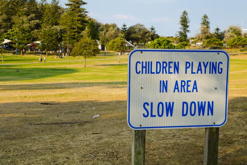 `Children playing in area slow down` for warning drive slowly. stock photography