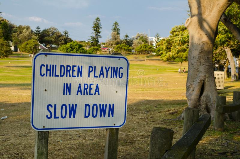 `Children playing in area slow down` for warning drive slowly. stock photos