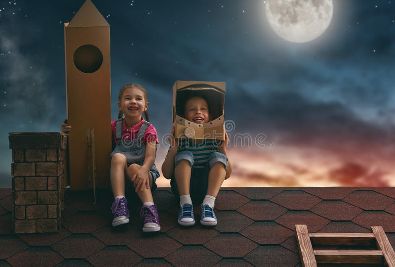 Children playing astronauts stock photography