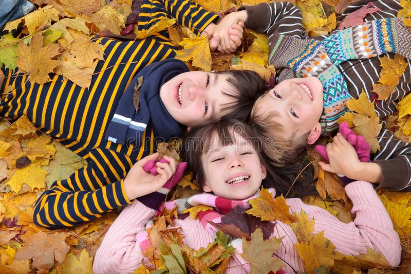 Children playing in Autumn royalty free stock photography