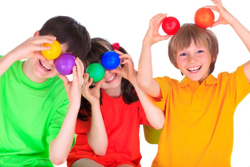 Children playing with balls stock photos