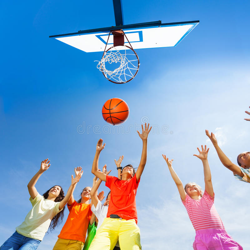 Children playing basketball view from bottom. Children playing basketball together view from bottom stock photography