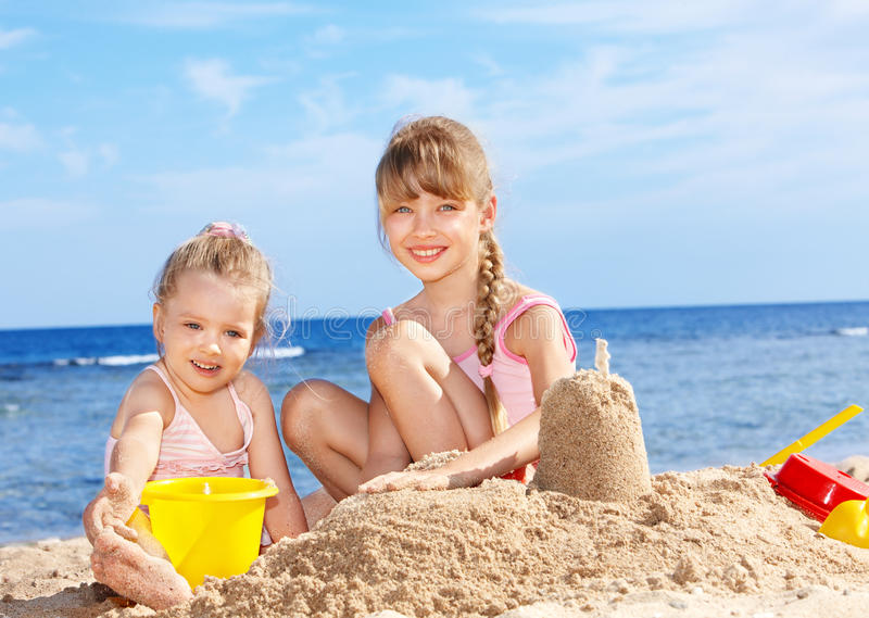 Children playing on beach. royalty free stock images