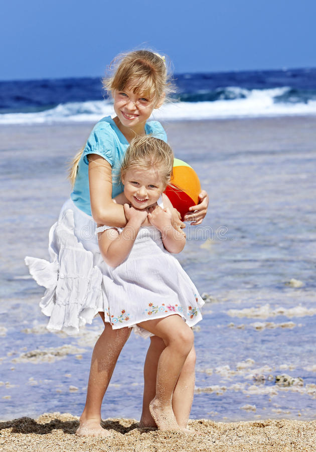 Download Children  Playing On  Beach. Stock Image - Image: 18349959