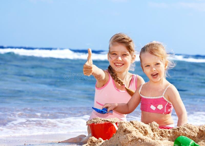 Children playing on beach. stock photo