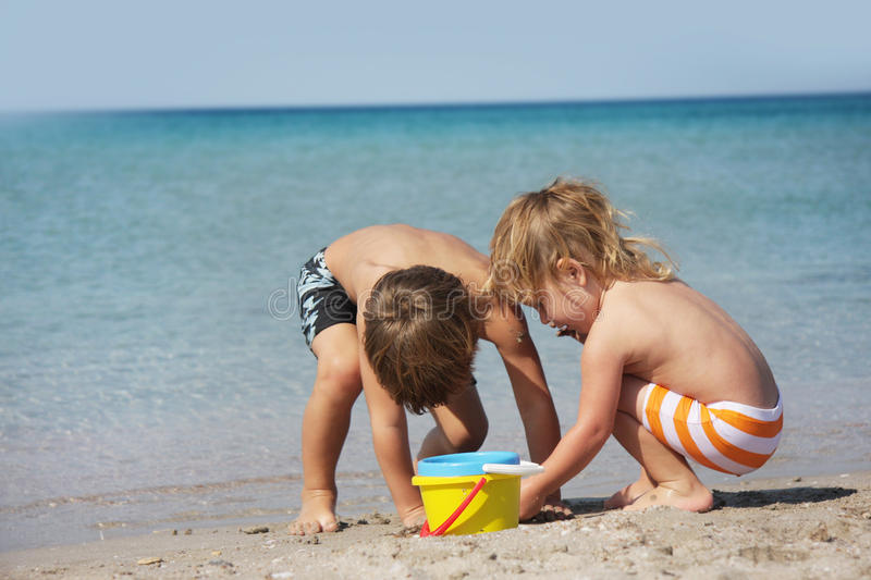 Children playing on beach royalty free stock photo