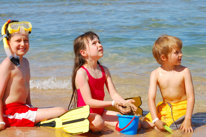 children playing at the beach royalty free stock photo