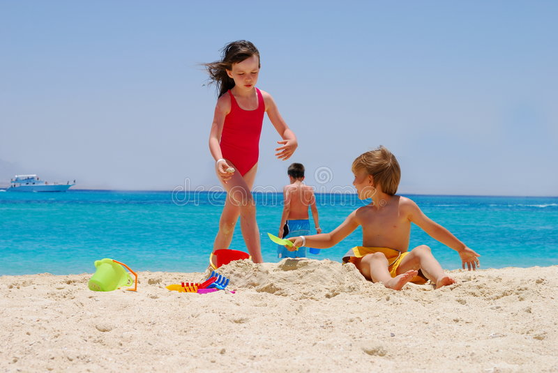 Download Children Playing On Beach Royalty Free Stock Photos - Image: 2614678