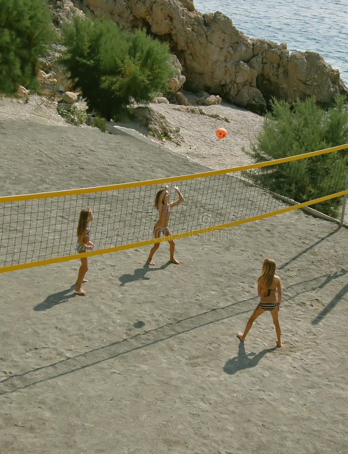 Children playing beach volleyball stock photo