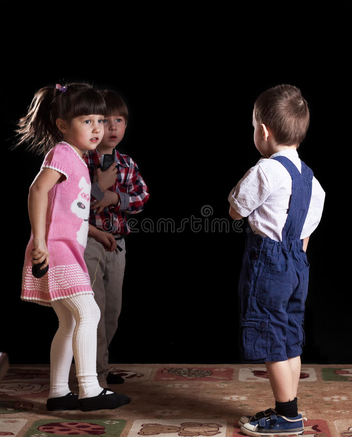 Children playing on a black background royalty free stock image