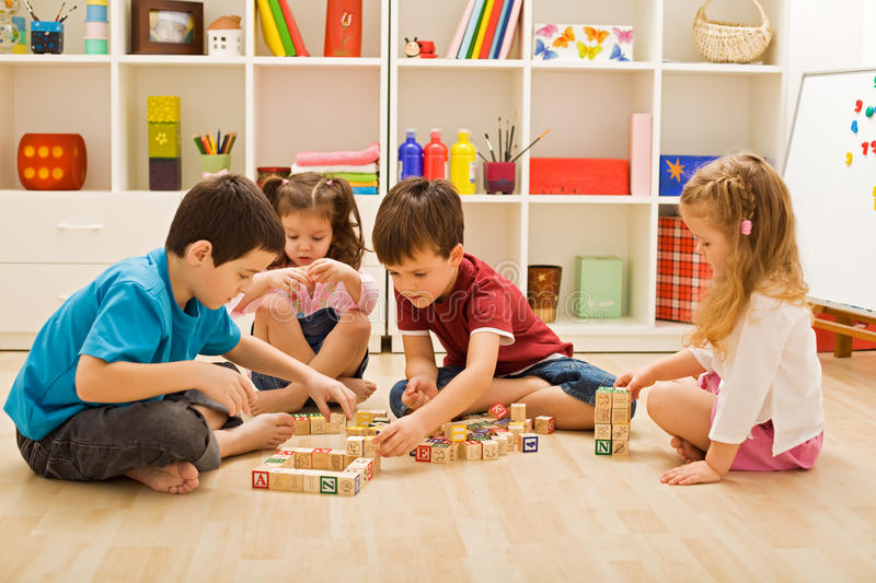 Children playing with blocks stock image