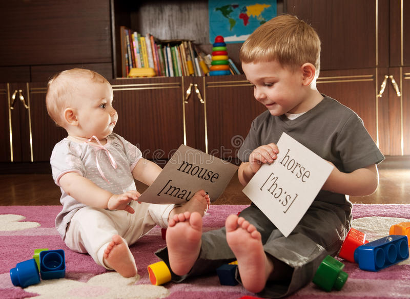 Children playing with cards royalty free stock images