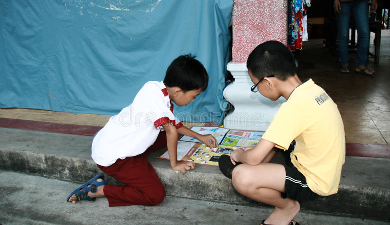 The children playing chess in hoi an ancient town,vietnam stock photos