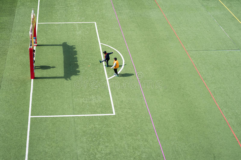 Children playing in a chinese school stadium high angle view royalty free stock photography