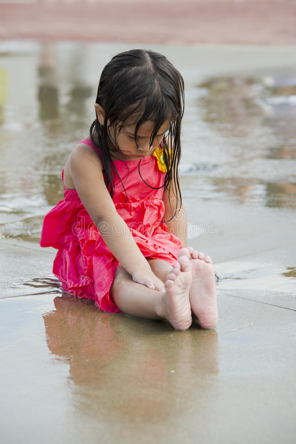 Children playing in a city water park play ground royalty free stock image