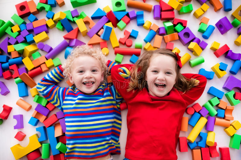 Children playing with colorful blocks. stock image