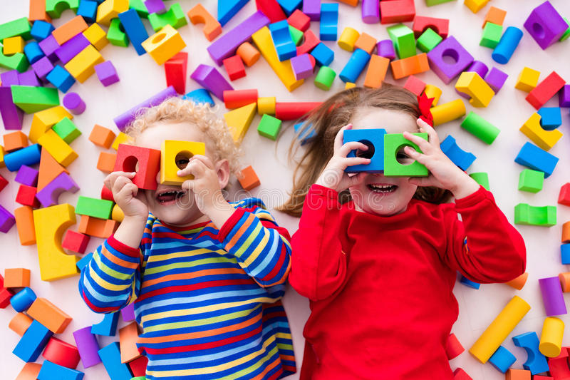 Children playing with colorful blocks. royalty free stock photography
