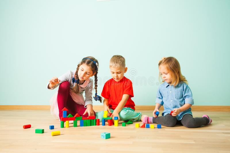 Children playing with colorful blocks at preschool royalty free stock photography