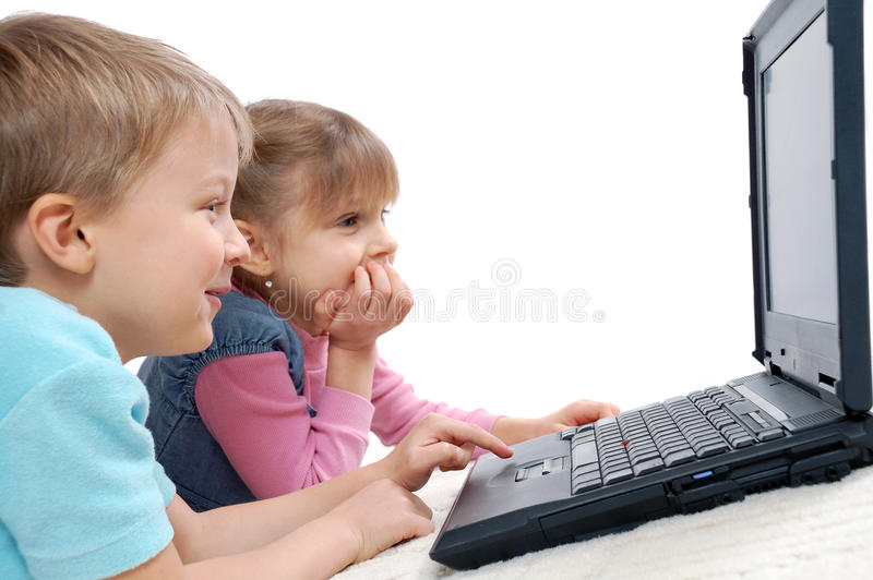 Children playing computer games stock image