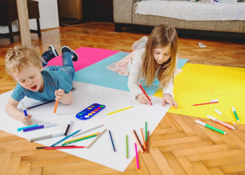 Children are playing and drawing. stock photo