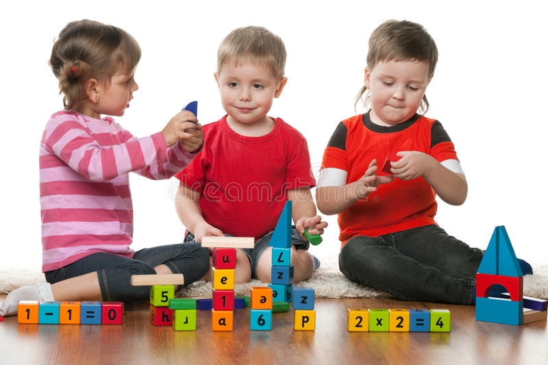 Children playing on the floor together royalty free stock photo