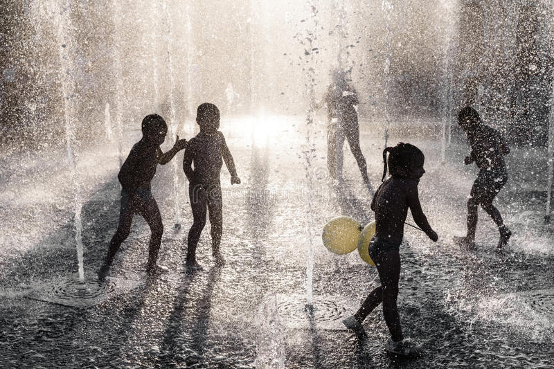 Download Children Playing In A Fountain Editorial Photography