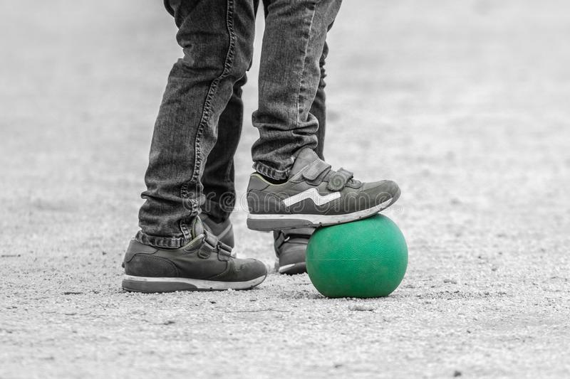 Children playing with a green ball in the square of the couples of aranjuez stock images