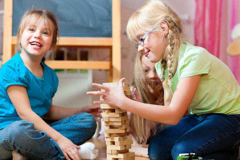Children playing at home royalty free stock photos