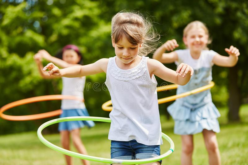 Children playing with hoops. In the park royalty free stock photography