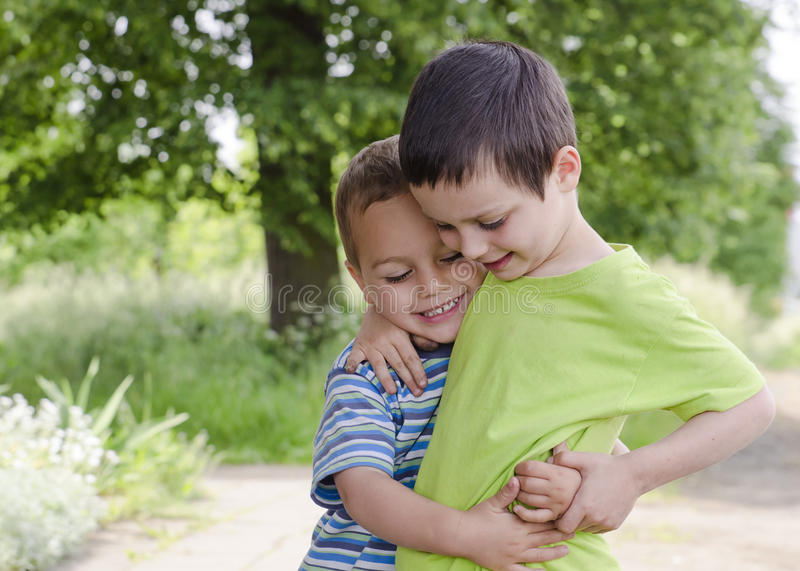 Children playing and hugging stock image