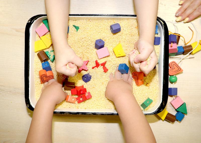 Children playing with kinetic sand, croup and designer in preschool. The development of fine motor concept. Creativity Game. Creativity Game concept. Children royalty free stock photo