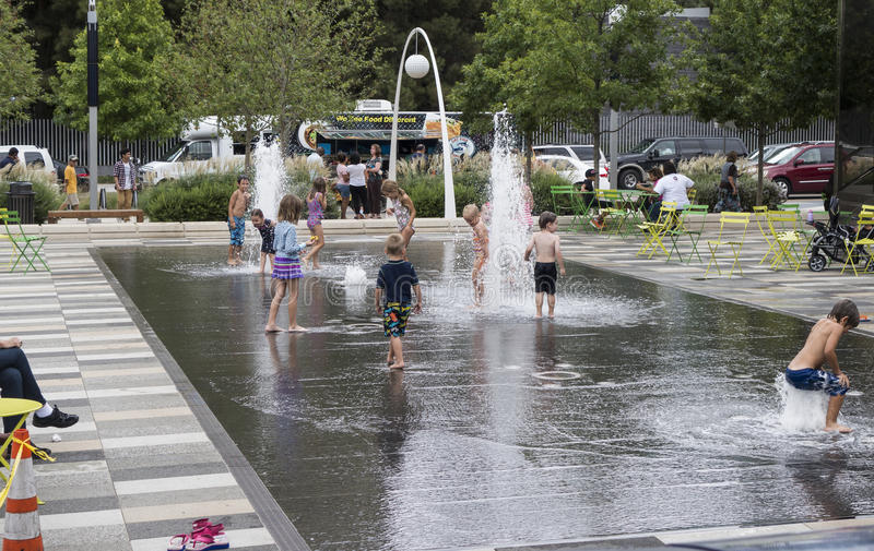 Children playing in Klyde Warren park fountain royalty free stock photography