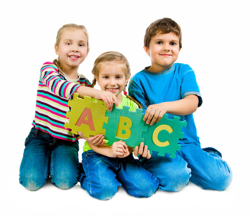 Children are playing letters stock photography